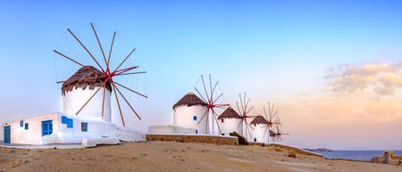 Panoramic view of traditional greek windmills on Mykonos island at sunrise, Cyclades, Greece Standard-Bild