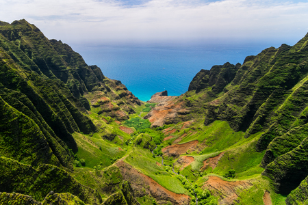 Aerial landscape view of cliffs and green valley, Kauai, Hawaii, USA
