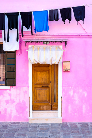 vivid: Colorful house and washed clothes on a rack, Burano island, Venice, Italy Stock Photo