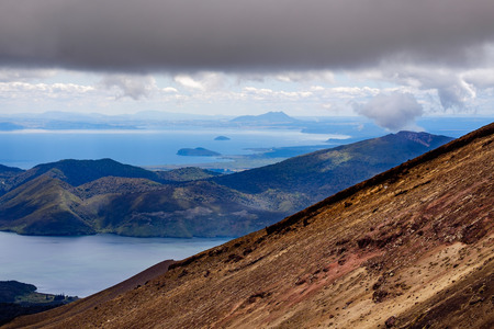 stratovolcano: Volcanic landscape and ocean view at Tongariro national park, New Zealand Stock Photo