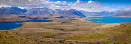 Panoramic landscape view of lakes and mountains, Lake Tekapo, Southern Alps, South island of New Zealand