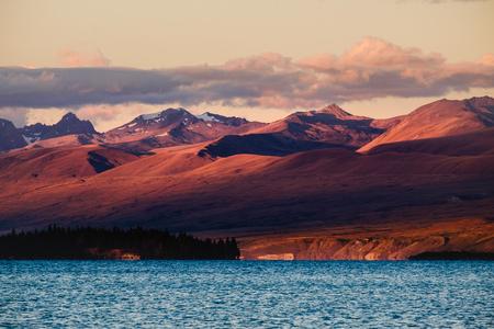 newzealand: Landscape view of Lake Tekapo mountains at dramatic sunset, South island of New Zealand Stock Photo