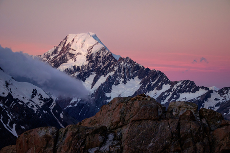 tasman: Scenic sunset view of Mt Cook summit with colorful sky, Southern Alps, New Zealand Stock Photo