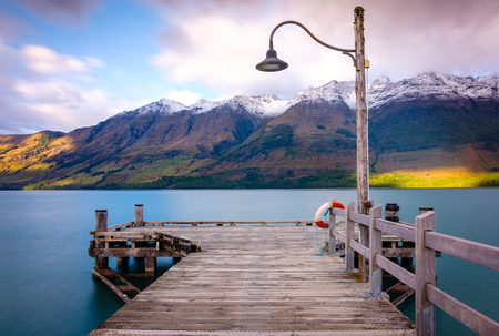 Glenorchy wharf wooden pier and lamp after sunrise, South island of New Zealand