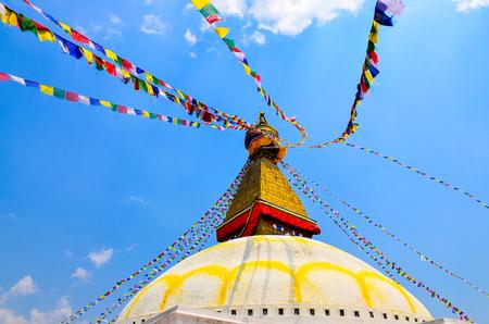 Bouddhanath stupa detail with colorful buddhist flags, Kathmandu, Nepal