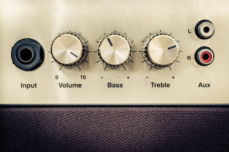 amp: Close-up detail of sound volume controls in vintage style