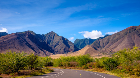 Landscape view of mountains on West Maui and the road, Hawaii, USA
