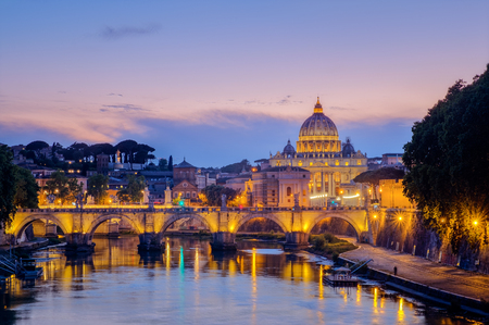 Famous citiscape view of St Peters basilica in Rome at sunset, Italy Stock Photo