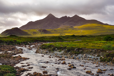 Dramatic landscape of Cuillin hills and river, Scottish highlands, United Kingdom Stock Photo