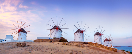 Panoramic view of traditional greek windmills on Mykonos island at sunrise, Cyclades, Greece Stok Fotoğraf
