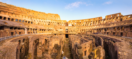 amphitheatre: Panoramic view of Roman colosseum interior at colorful sunset, Rome, Italy