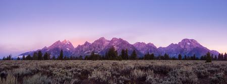Panoramic view of colorful sunrise at Grand Teton, Wyoming, USA Stock Photo