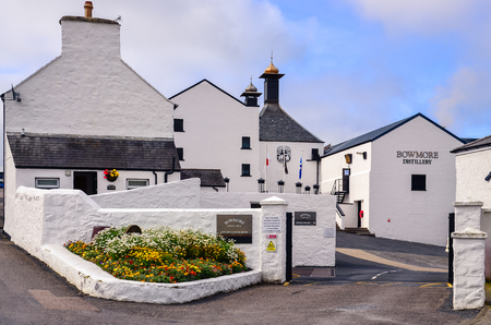 ISLAY, UNITED KINGDOM - 26 August 2013: Entrance to Bowmore distillery factory, Islay, United Kingdom