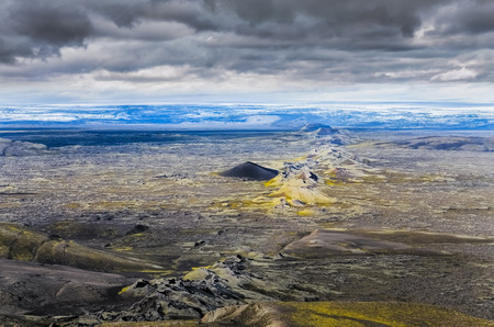 Dramatic volcanic landscape with chain of craters and glacier background, Lakagigar, Iceland