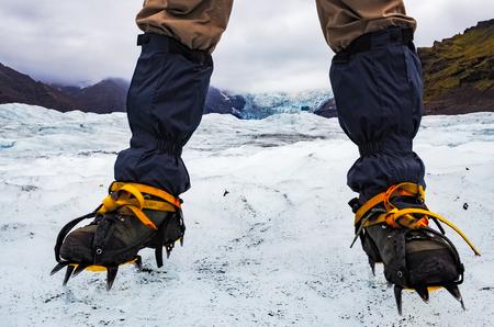 crampon: Mountaneers feet with crampons on the frozen glacier, Vatnajokull, Iceland