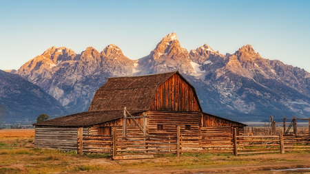 Landscape view of Grand Teton mountain range and abandoned barn, Wyoming, USA Stock Photo