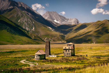 Landscape view of Caucasus mountains and stone houses and tower, Kazbegi region, Country of Georgia