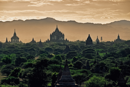Dark moody sunset with ancient temples in Bagan, Myanmar (Burma)