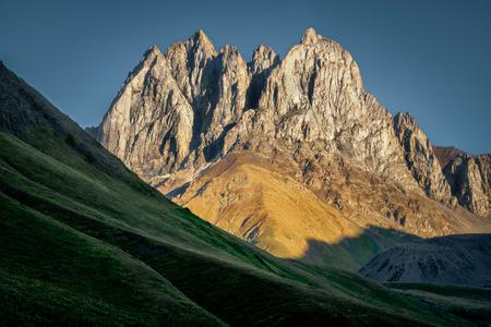 Landscape view of mountain peaks and meadows in Kazbegi national park, Country of Georgia Zdjęcie Seryjne