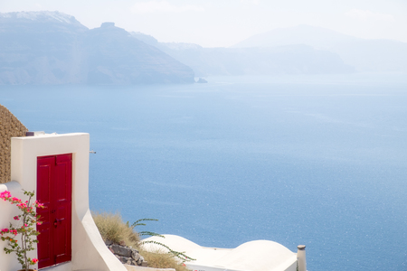Detail of red terrace door with ocean background, Santorini, Greece