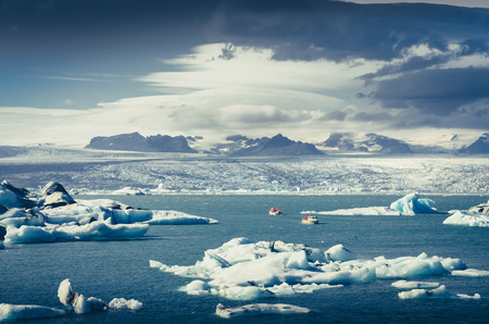 Landscape view of Jokullsarlon lagoon with floating ice and boats, Iceland, Europe