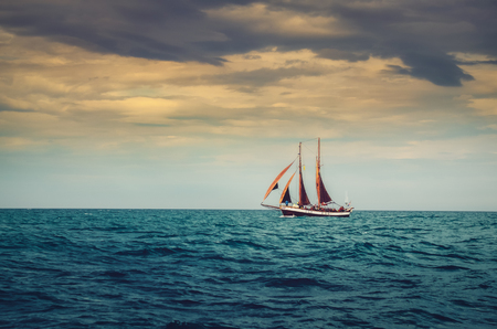 Traditional sailing ship in the ocean, dramatic moody style
