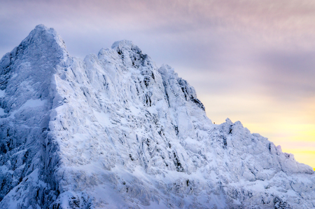 Beautiful winter landscape with lonely climber and snowed mountain peaks, High Tatras, Slovakia, Europe