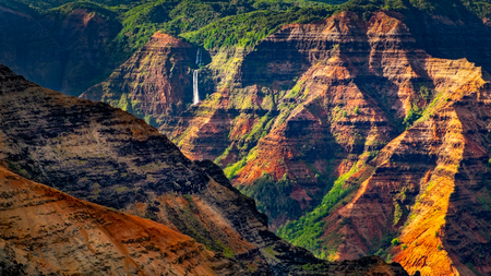 Landscape detail of beautiful Waimea canyon colorful cliffs and Waipoo waterfall, Kauai, Hawaii, USA