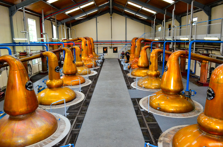 DUFFTOWN, UNITED KINGDOM - 5 SEPTEMBER 2013: Interior of Glenfiddich distillery hall with pot stills
