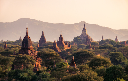 Landscape view of ancient temples at colorful golden sunset, Bagan, Myanmar (Burma) Zdjęcie Seryjne