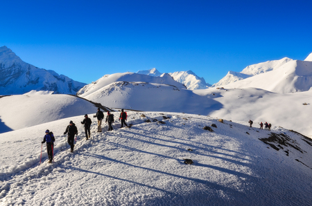 NEPAL, HIMALAYAS - 1 May 2013: Group of mountain trekkers in Himalayan mountains near Thorong La pass, Annapurna region
