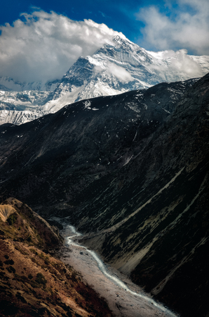 Landscape view of mountain valley, peaks and river in Himalayas, Annapurna region, Nepal, Asia