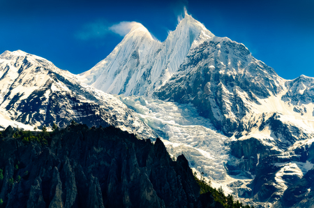 Mountain peaks with glaciers and snow and blue sky, Annapurna region in Himalayas, Nepal, Asia