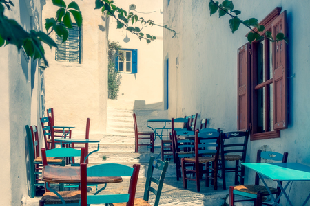 Traditional mediterranean colorful street on Amorgos island in dreamy filtered tones, Cyclades, Greece, Europe