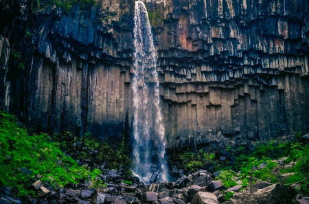 Landscape view of beautifol Svartifoss waterfall and volcanic rock walls, Iceland, Europe