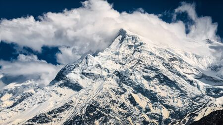 Mountain peaks with glaciers and snow and white clouds, Annapurna region in Himalayas, Nepal, Asia
