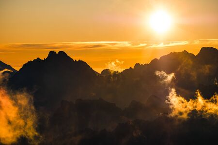 Sun rising over the beautiful mountains and clouds in High Tatras, Slovakia, Europe 免版税图像