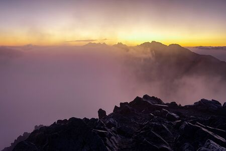 Colorful foggy sunrise over the mountains in High Tatras, Slovakia, Europe 免版税图像 - 140357902