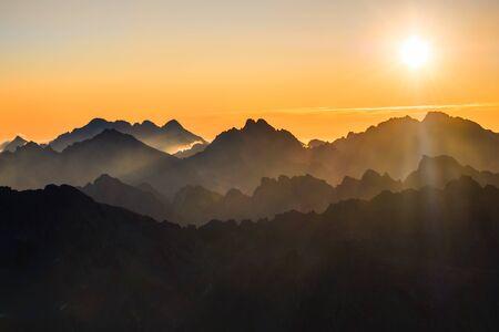 Sun rising over the beautiful misty layered mountains, High Tatras, Slovakia, Europe 免版税图像 - 131729581