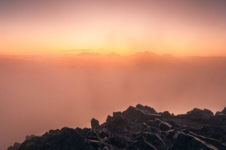 Colorful foggy sunrise over the mountains in High Tatras, Slovakia, Europe 免版税图像 - 131729134