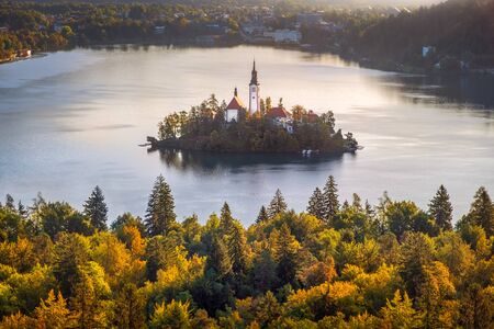 Colorful landscape view of and island and Lake Bled with colorful autumn foliage, Slovenia, Europe