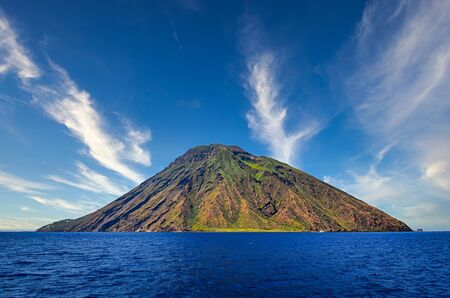 Volcanic island Stromboli in Lipari viewed from the ocean with nice clouds, Sicily, Italy 免版税图像 - 140357912