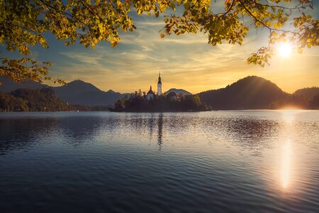Scenic view of Lake Bled and island with church, colorful dramatic sky, Slovenia, Europe 免版税图像 - 135162778