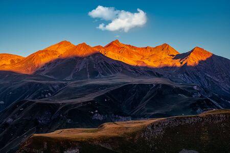 Beautiful mountain landscape sunrise with moody colours, Kazbegi, Country of Georgia 免版税图像