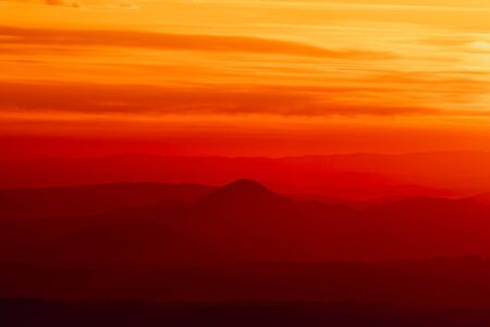 Tranquil landscape of layered mountains silhouettes during colorful sunrise, Slovakia, Europe 免版税图像 - 145809581