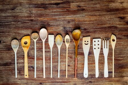 Detail of wooden cooking spoons on textured wooden table in vintage style 免版税图像
