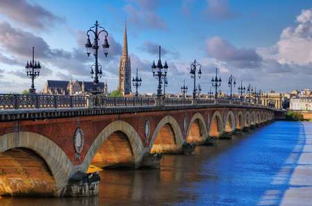 Scenic view of Bordeaux river bridge with St Michel cathedral and beautiful sky, Bordeaux, France