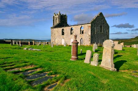 Landscape view of Old Kilchoman parish church on Isle of Islay, Scotland, United Kingdom 免版税图像