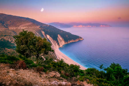 Landscape view of Myrtos beach at colorful sunrise, Kefalonia, Greece, Europe