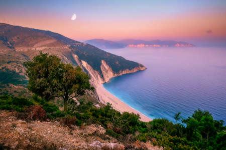Landscape view of Myrtos beach at colorful sunrise, Kefalonia, Greece, Europe